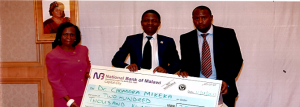 NCST Director General-Anthony Muyepa (right) and Head of Documentation and Information Services Gift Kadzamira (left) presents the cheque to Dr Mikeka (middle)