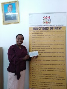 Mrs Kazembe happily showing off her grant